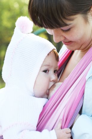 8094358 - walk with the child in a baby sling. breastfeeding